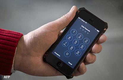 FBI, Apple clash in Congress on encryption
