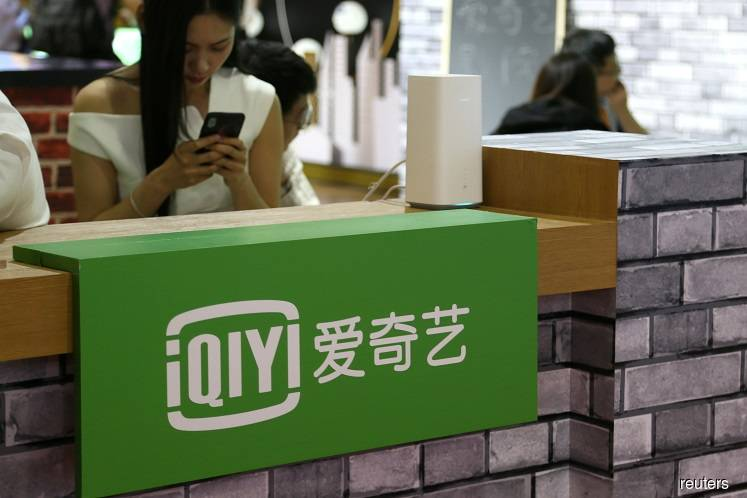 Tencent aims to become biggest shareholder of video-streaming rival iQIYI — sources.