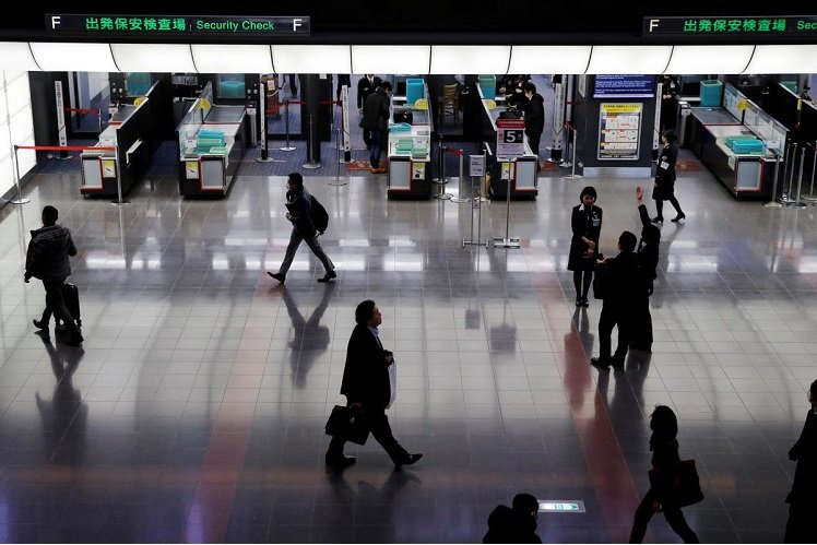 Japan mulls easing entry limits for four countries, Yomiuri says