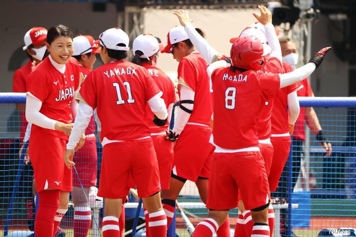 Japan win softball opener as Games 'of hope' begin