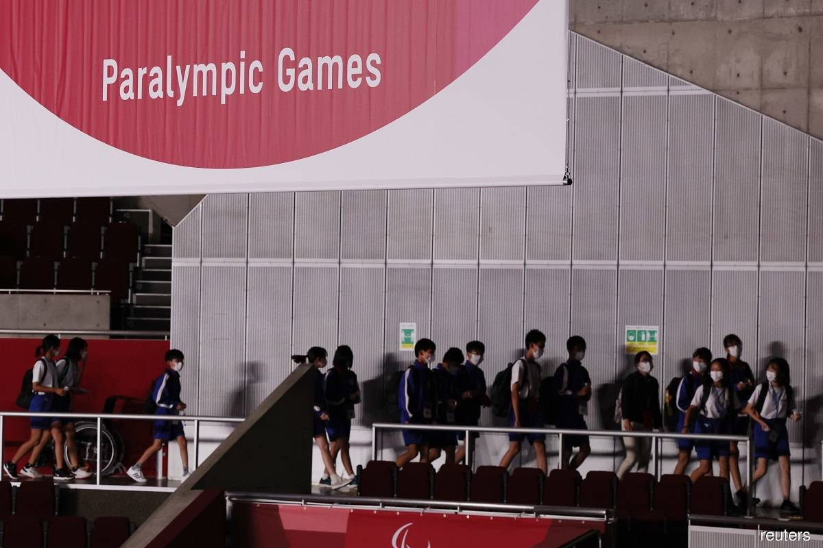 Japan finds Covid-19 infections in teachers who took students to Paralympic Games
