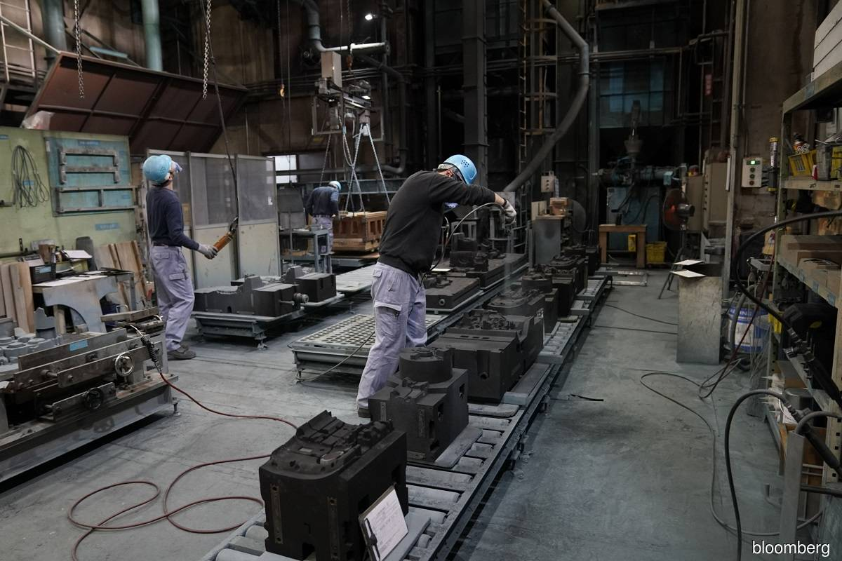 Japan's output seen rising as exports cushion pandemic's impact
