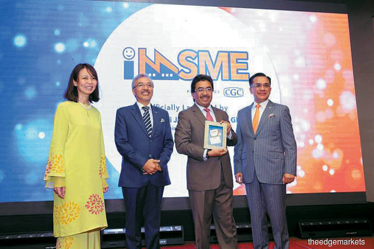 From left: Bank Negara Malaysia deputy governor Jessica Chew, Agil, Johari and Mohd Zamree at the launch of imSME