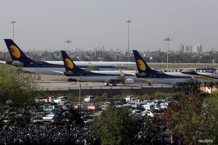 Grounded Jet Airways' shares sink, rivals race to grab airport slots