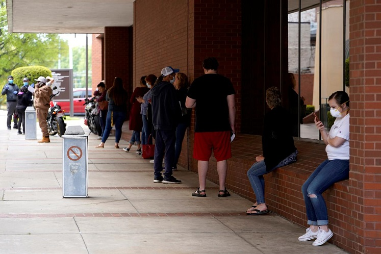 People who lost their jobs wait in line to file for unemployment following an outbreak of Covid-19, at an Arkansas Workforce Center in Fort Smith, Arkansas, US, April 6, 2020. (Photo by Reuters)