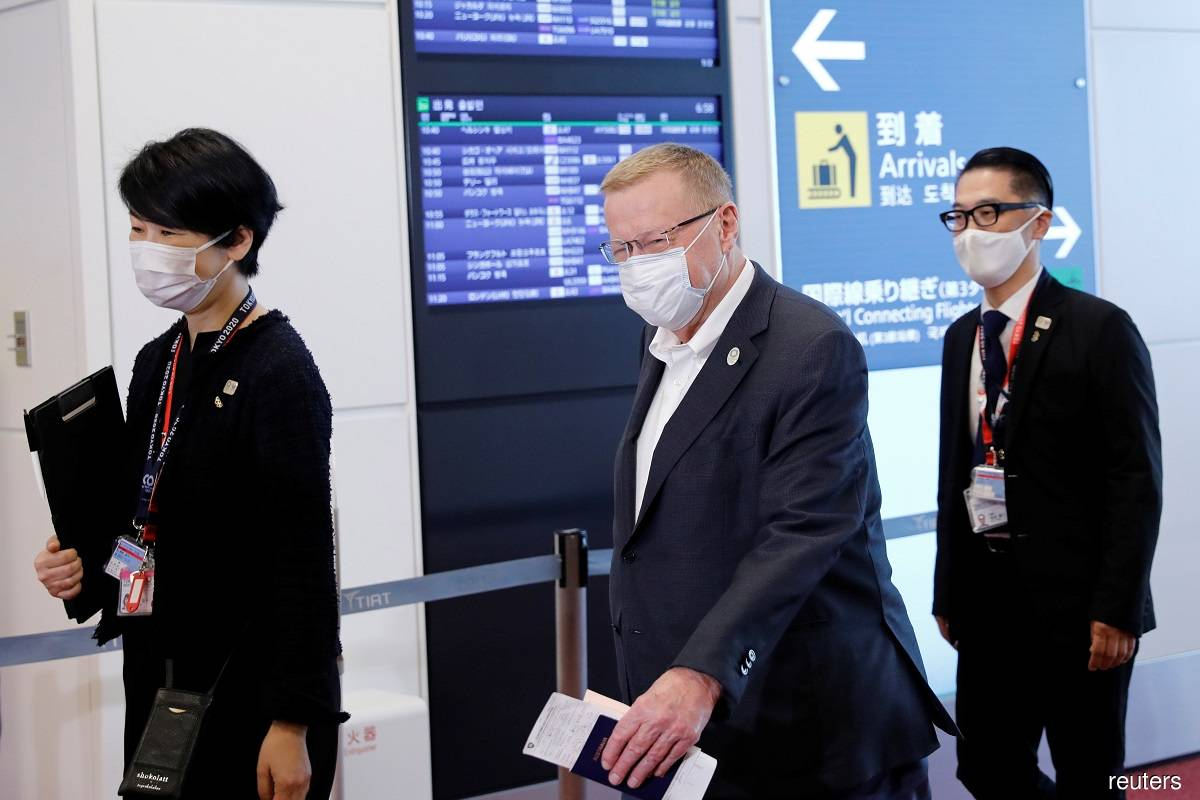 International Olympic Committee vice president and Tokyo 2020 Olympic Games Coordination Commission chairman John Coates (centre) arriving at the Haneda Airport in Tokyo, Japan on June 15, 2021.