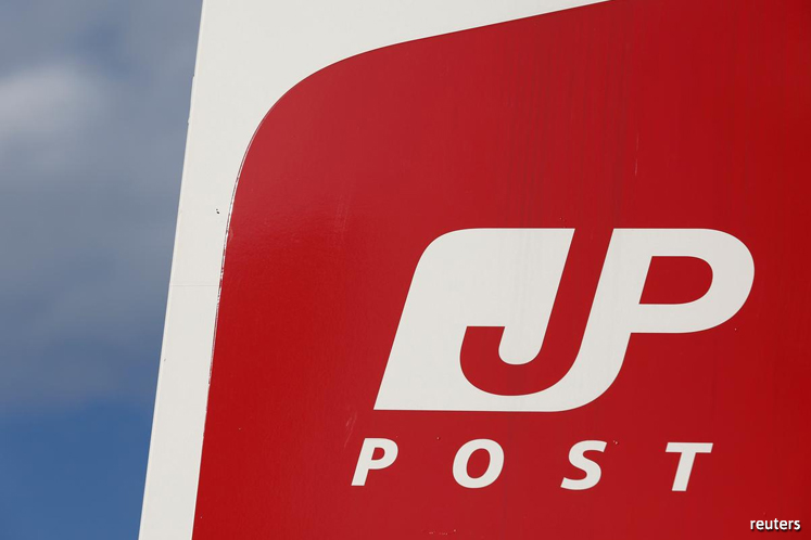 Japan Post Bank tumbles most on record on weak forecast