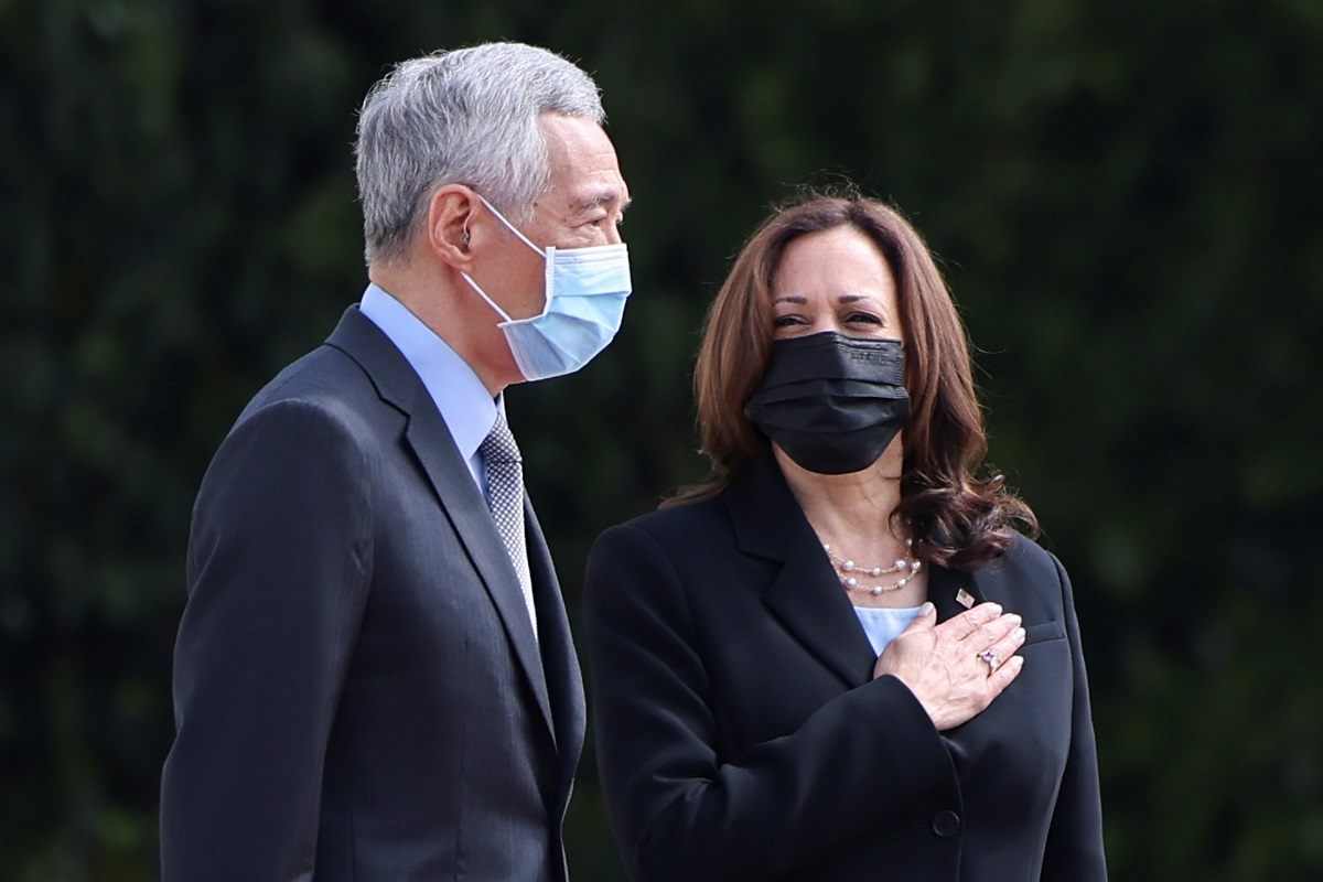 US Vice President Kamala Harris stands next to Singapore's Prime Minister Lee Hsien Loong during a welcome ceremony at the Istana in Singapore Aug 23, 2021. (Photo by Reuters)