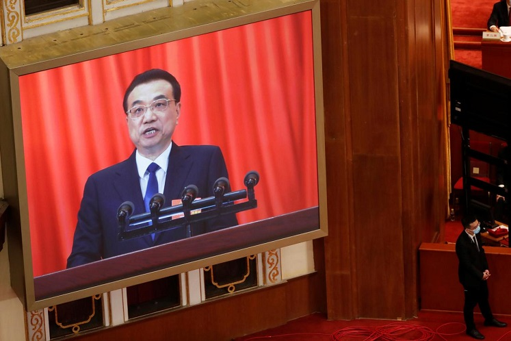 """We have reserved policy room. Be it fiscal, finance, or social security,"" Li said during his once-a-year news conference following the close of the annual meeting of parliament. (Photo by Reuters)"