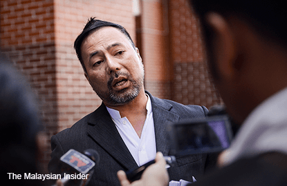 Cops arrest former Umno man after barring him from leaving country