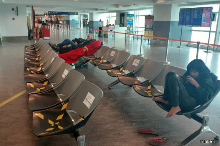 'All we have left is to hope and pray': Travelers stranded in airport by coronavirus