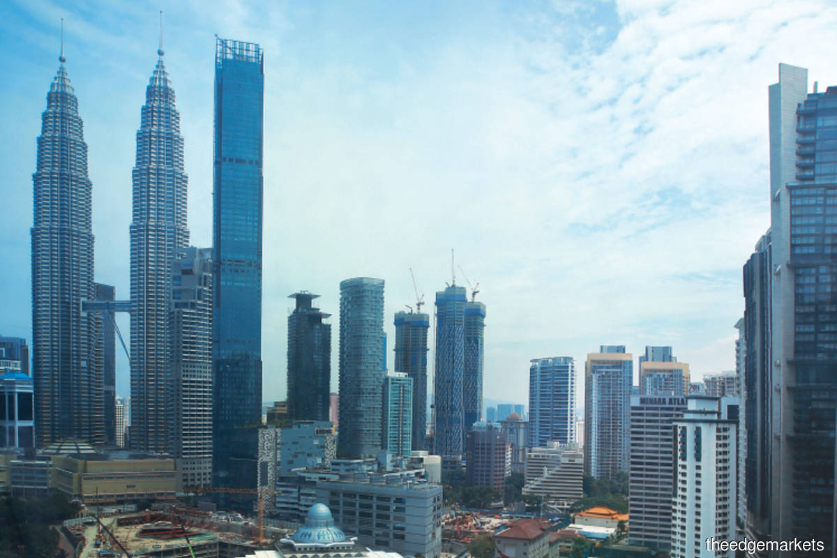 Fitch downgrades Malaysia's sovereign rating to BBB+, the first downgrade since Asian Financial Crisis