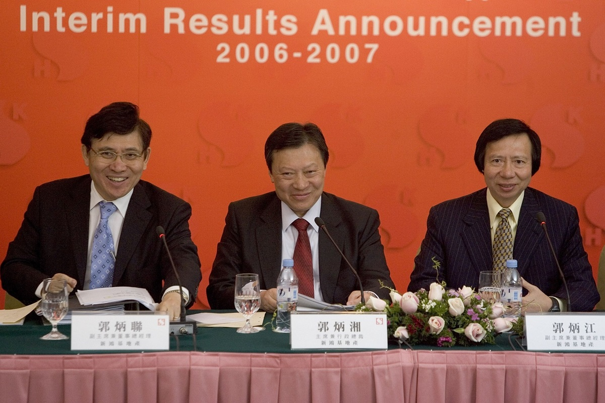 (From left): Raymond Kwok, Walter Kwok and Thomas Kwok in 2007. (Photo by Bloomberg)