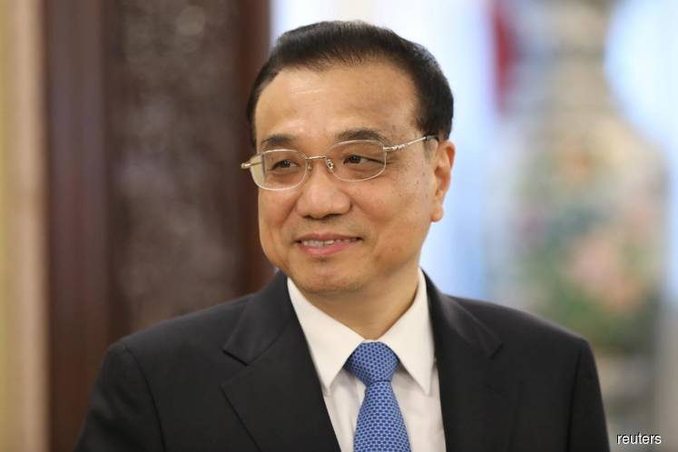 China will cut banks' reserve requirements, taxes: Premier Li
