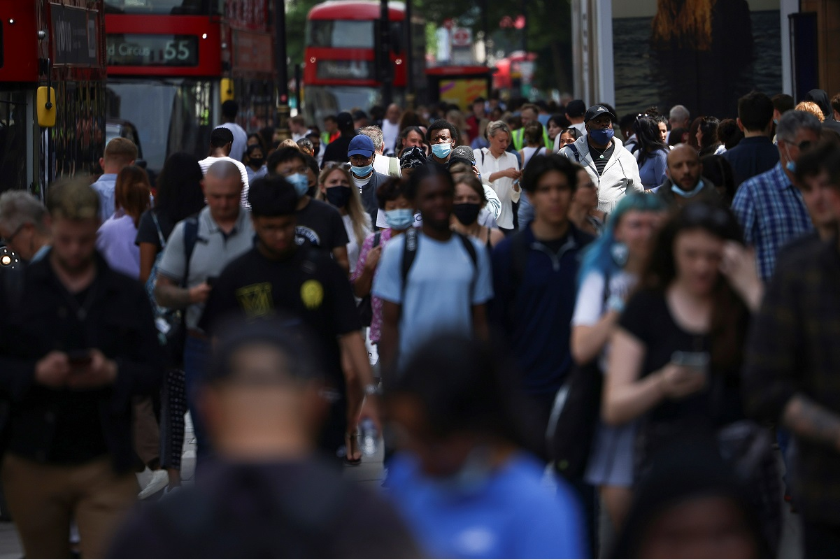 People walk along Oxford Street, amid the Covid-19 outbreak, in London, Britain, July 26, 2021. (Photo by Reuters)