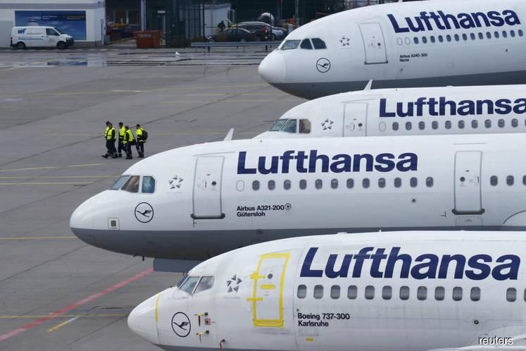 Lufthansa shares tumble after warns on profit