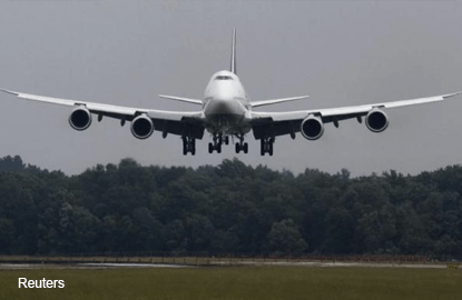 Boeing to cut 747-8 production in half as demand slows