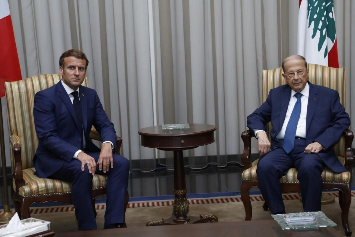 Lebanon's President Michel Aoun meets with French President Emmanuel Macron upon his arrival at the airport in Beirut, Lebanon Aug 6, 2020.