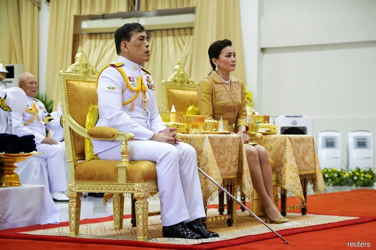 Thailand's King Maha Vajiralongkorn (left) and Queen Suthida (right) attending Prince Mahidol Day celebrations at the Siriraj hospital in Bangkok, Thailand yesterday.