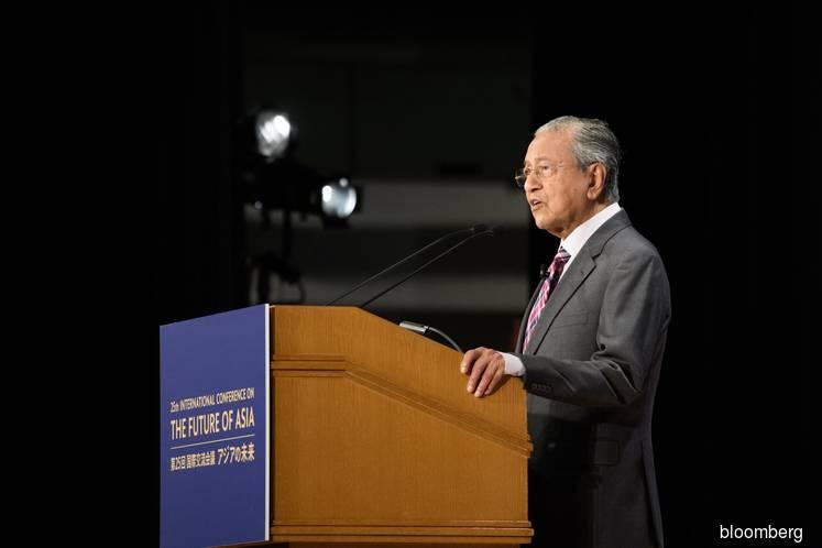 Dr Mahathir backs Huawei in rare public rebuke of US clampdown
