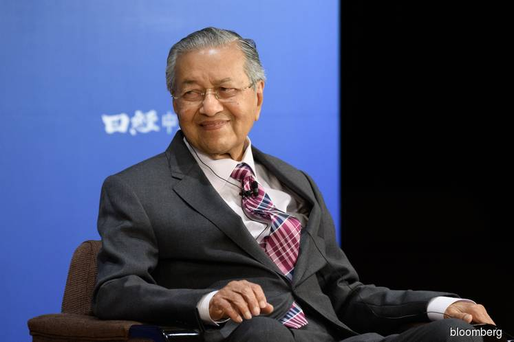 Dr Mahathir reaffirms promise to hand over premiership to Anwar