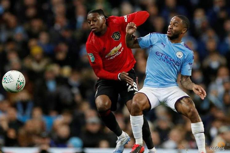 City lose to United but hang on to reach final