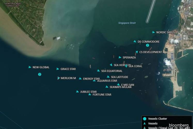 Oil tankers are anchored off Singapore hoarding fuel