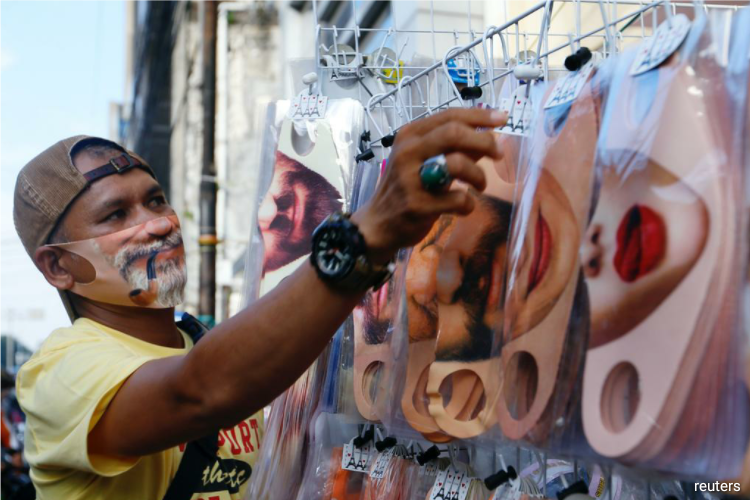 Bespoke masks are catching on in Indonesia, with customers ordering designs with their own faces printed on reusable neoprene material, some with smiling faces, or big red lips. (Photo by Reuters)