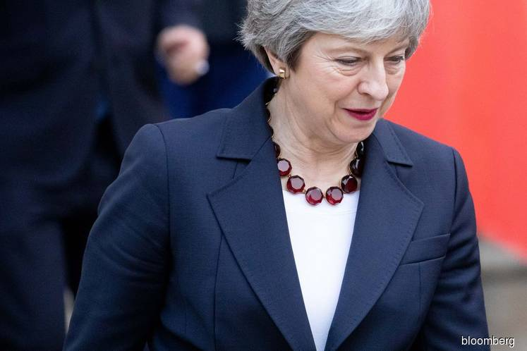EU Set to Force U.K. Into Long Brexit Delay in Danger for May