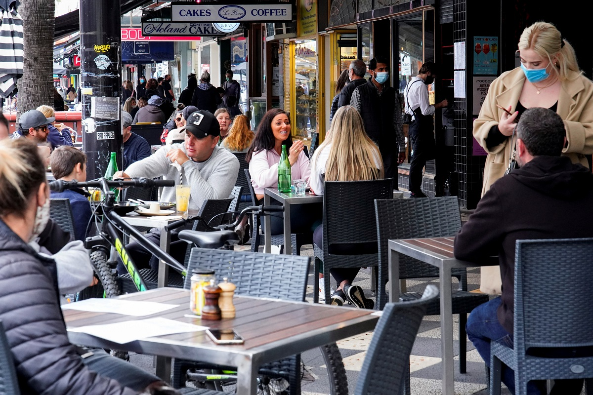 Diners eat outside St Kilda's Rococo restaurant on the second day of eased Covid-19 regulations, following a lockdown to curb an outbreak, in Melbourne, Australia, Oct 23, 2021. (Photo by Reuters)