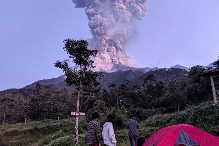 Indonesia's most volatile volcano spews ash in new eruption