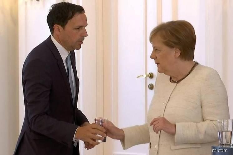 Merkel's health under spotlight at G-20 after shaking spells