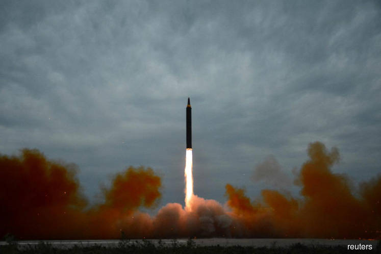 N.Korea's Kim says missile test was for Guam, Trump warns all options open