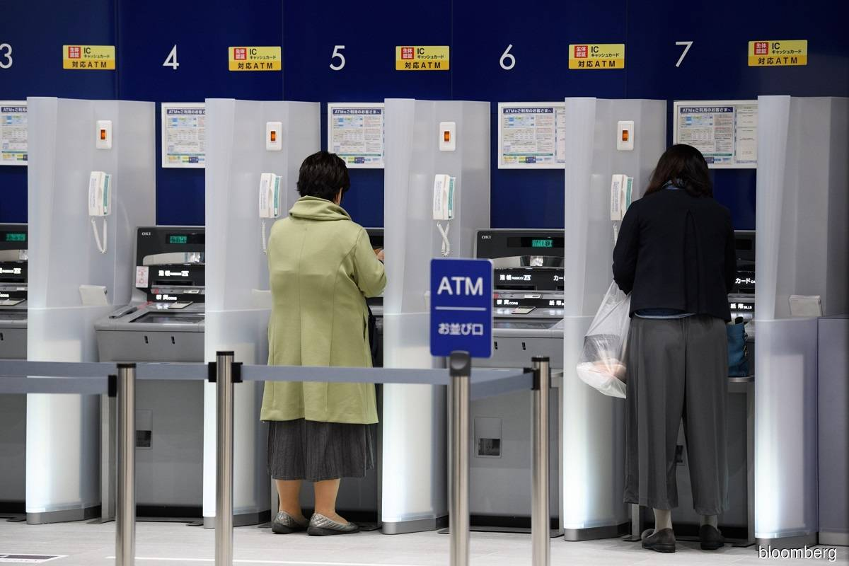 Japan's Mizuho restores ATMs, online banking after glitch halts services