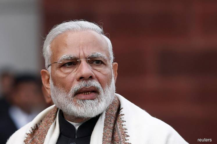 India's Modi takes early lead as counting of 600 mil votes begins