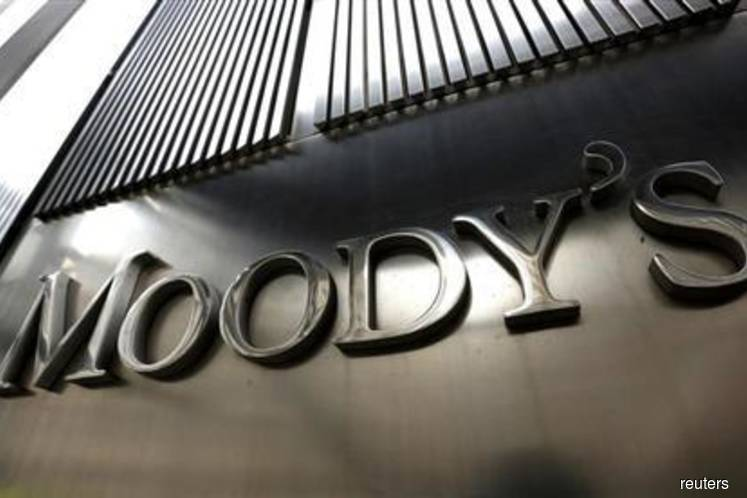 Moody's cuts outlook for Singapore banks on coronavirus fallout