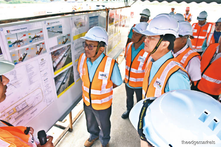 Baru (right) together with MRCB-George Kent and CIDB officials touring the LRT3 construction site yesterday.