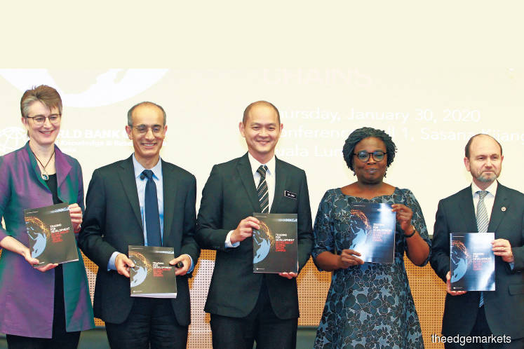 (From left) World Bank country director Dr Mara Warwick, Mattoo, Deputy International Trade and Industry Minister Dr Ong Kian Ming, World Bank regional vice-president Dr Victoria Kwakwa and country manager for Malaysia Dr Firas Raad at a World Bank panel session yesterday. (Photo by Patrick Goh)