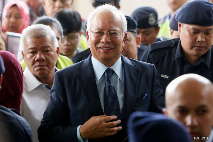 AG withdraws 3 money laundering charges against Najib