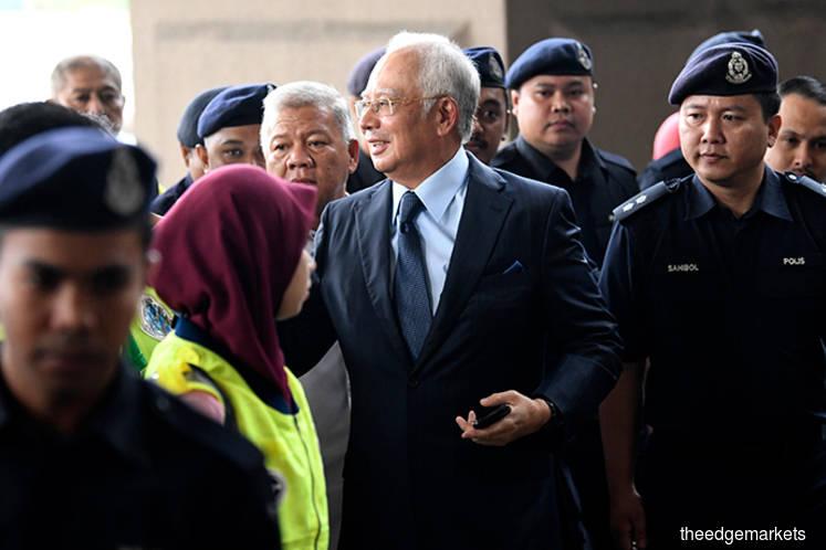 Long list of charges against Najib as 1MDB trial kicks off