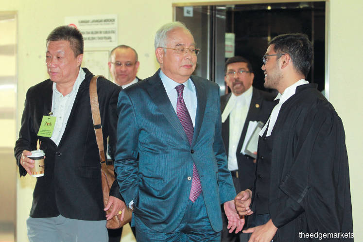Najib did not complain about transactions in his accounts — witness
