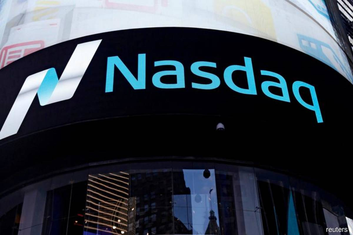 Nasdaq hits correction, Dow advances as stimulus bill nears finishing line