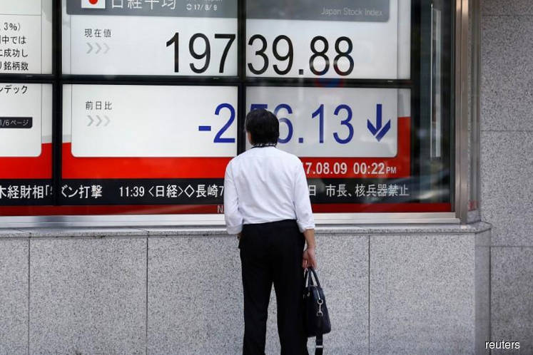 Nikkei ends flat as disappointing earnings erase earlier gains