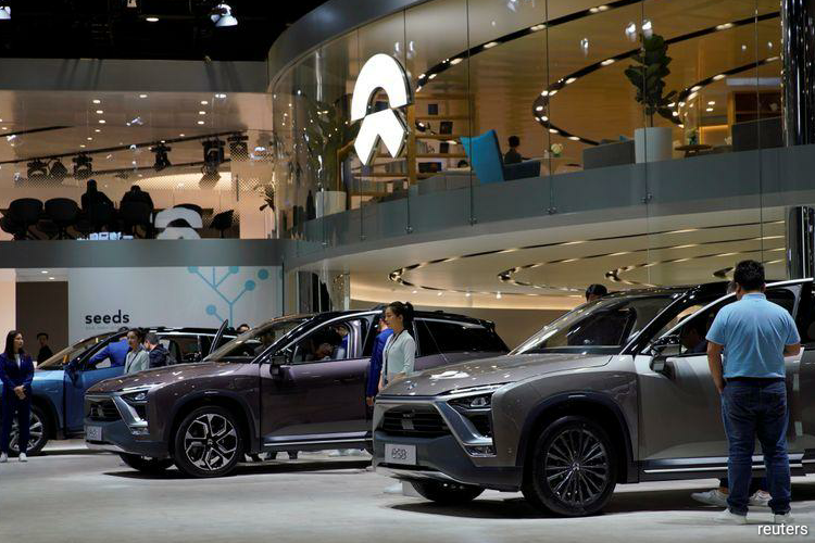 China electric auto champ NIO chases Tesla with $1bn state funding