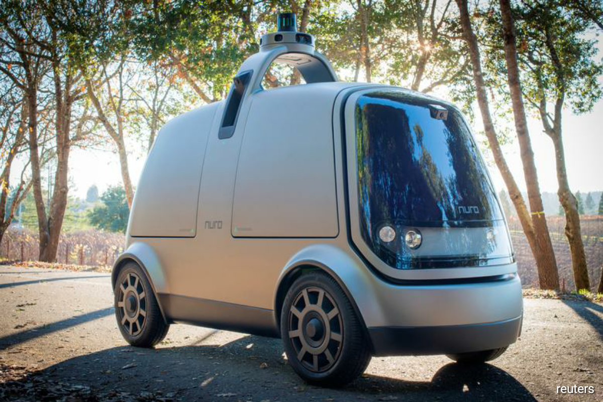Nuro has been testing autonomous vehicles on California's roads with safety drivers since 2017, and it was authorized by the state regulators to test two driverless delivery vehicles in nine cities earlier this year. (Photo by Reuters)