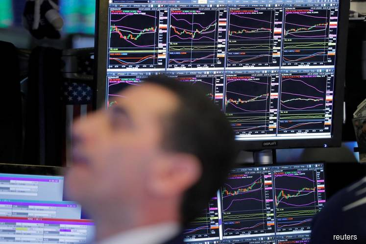 Wall Street drops as virus stokes economic concerns