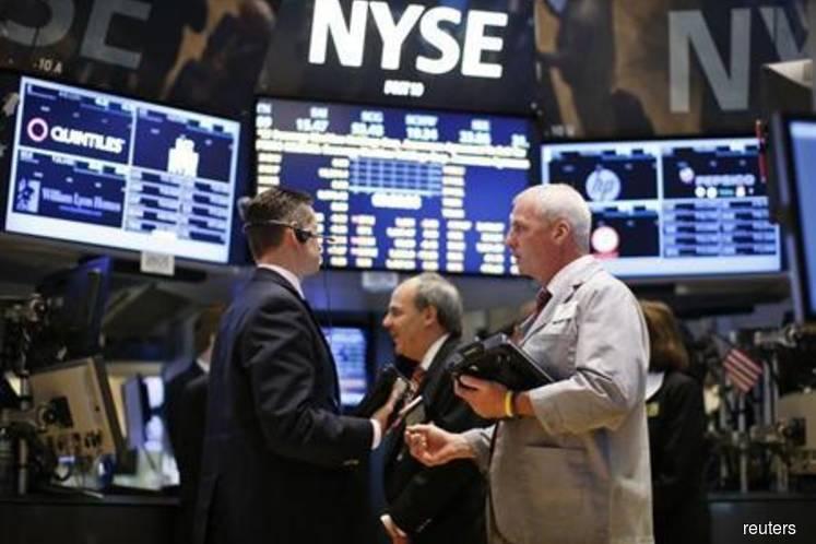 Wall Street drops on tech slide, Washington turmoil