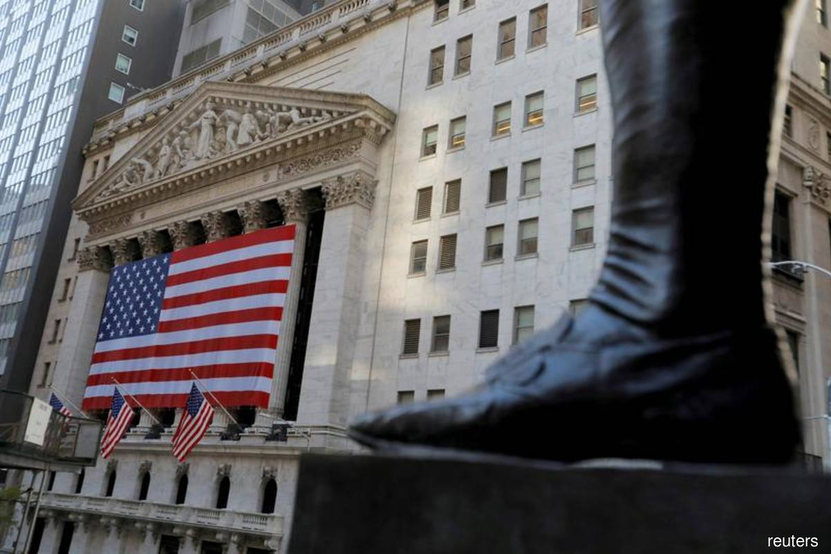S&P closes higher with defensive sectors leading gains