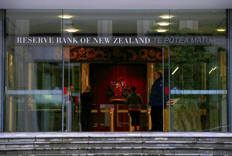 NZ central bank expands bond-buying, flags negative rates as nation locks down again