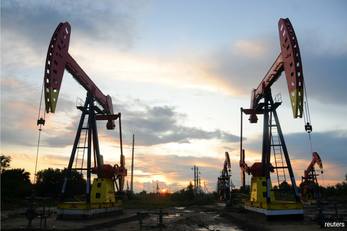 The IEA revised down its estimates for oil demand this year by 50,000 barrels per day (bpd) and for next year by 170,000 bpd, citing scarce jet fuel use as fewer people travel by air. (Photo by Reuters)